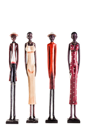 four statuettes depicting black people isolated over a white background
