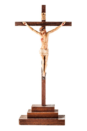 a simple crucifix isolated over a white background photo