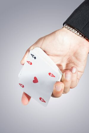 an elegant young businessman showing an ace of hearts in his hand photo