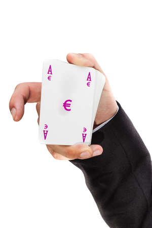 swaps: an elegant young businessman showing an ace in his hand Stock Photo