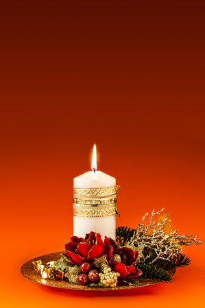 ornated: a beautiful ornated christmas centerpiece with a lit white candle