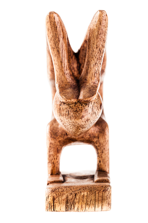 ebony wood: a statuette depicting a yoga position isolated over a white background