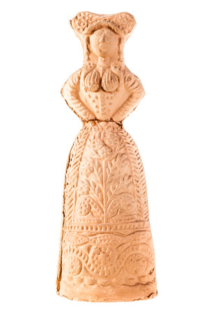 an ancient terracotta statuette from Basilicata, Italy. Isolated over white photo