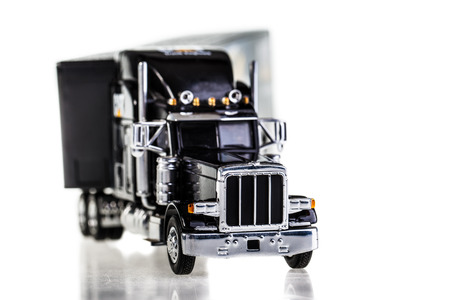 freightliner: a black lorry model isolated over a white background