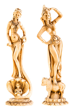 vedic: two indian statuettes isolated over a white background