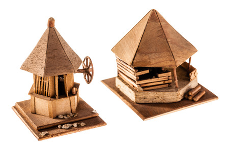 rumanian: Wooden models of Romanian izbas isolated on a white  Stock Photo