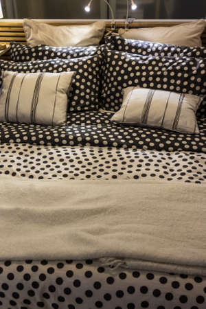 a cozy double bed with pillows and linen photo