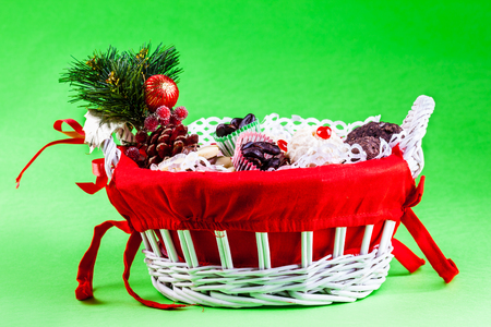 a festive christmas basket filled with cookies and candy over a green  photo