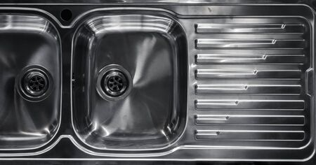 a new and shiny double bowl sink seen from above photo