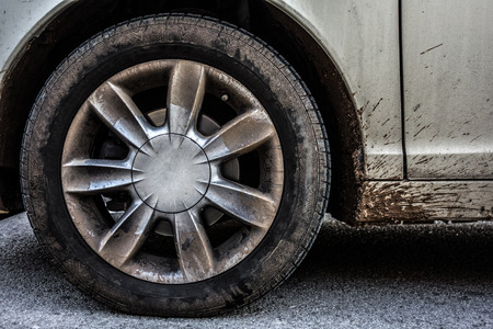 a weathered car wheel with mud and dirt Stock Photo - 26437308