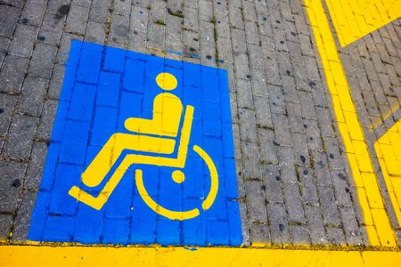 detail of the symbols painted on a disabled reserved parking lot photo