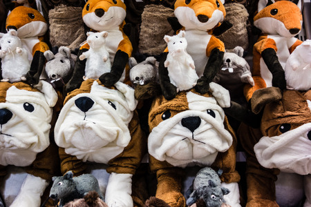 a lot of cuddly stuffed animals arranged in rows photo