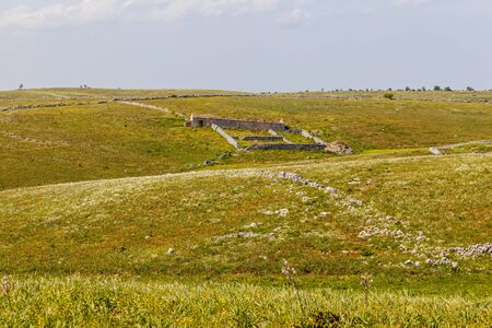 intended: The jazzo is a special enclosure for sheeps in common use in the territory of the Murgia (Puglia), built along the tracks and intended for the temporary shelter of the sheep during the long journey of transhumance. Stock Photo