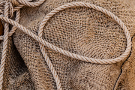 an old hemp rope on a brown jute sack Stock Photo