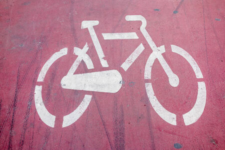 a bycicle signal painted on the asphalt of a street photo