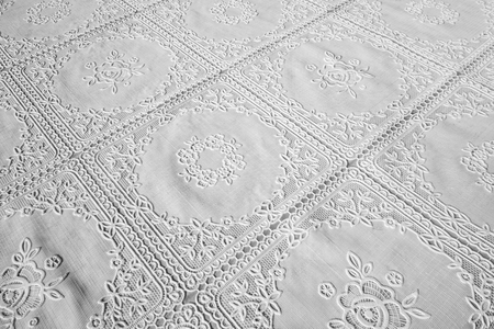 detail of a beautifull ornated white tablecloth Reklamní fotografie