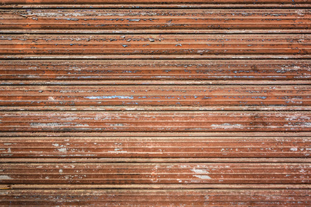 close up shot of a rusty and scratched roll up door photo