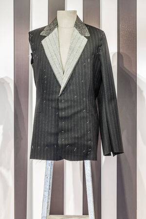 detail of an unfinished suit in a tailor shop Stock Photo