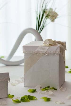 a white table with wedding favors in a big luxurious hall Stock Photo - 27260190