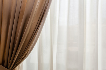 luxury beige drapes in a big luminous hall Standard-Bild