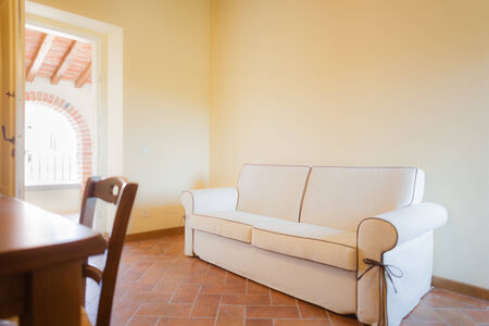 a warm an cozy living room with a cream colored sofa Stock Photo - 27260151