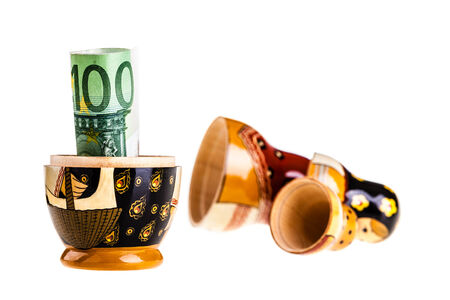 russian nested dolls: Russian doll with euro inside isolated on white  Stock Photo