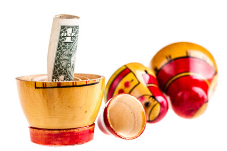 matroushka: Russian doll with dollars inside isolated on white