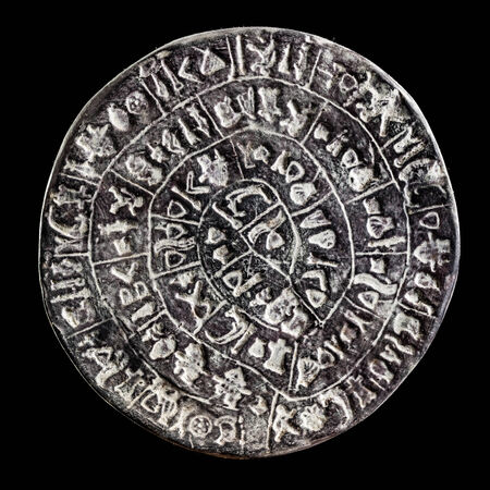 decipher: The Phaistos Disc is a disk of fired clay from the Minoan palace of Phaistos on the Greek island of Crete