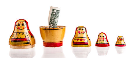 matriosca: Russian doll with dollars inside isolated on white background