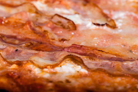speck: close up shot of a delicious pizza with speck and smoked cheese Stock Photo