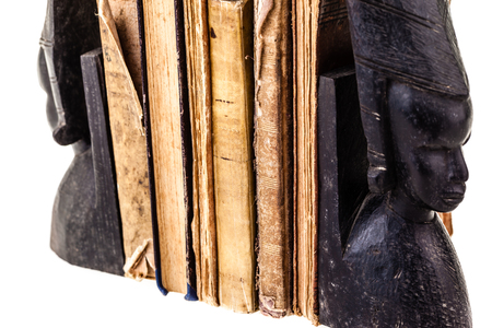 close up shot of some anciend and worn books photo