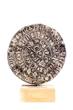 The Phaistos Disc is a disk of fired clay from the Minoan palace of Phaistos on the Greek island of Crete photo