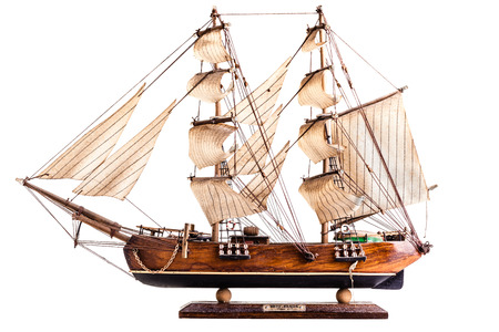 barque: A barque is a sailing vessel with three masts having the foremasts rigged square and only the aftermast rigged fore-and-aft. Stock Photo
