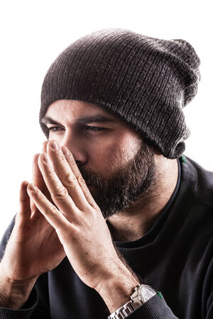 portrait of a thinking man with a beany and a beard, maybe a rapper or a gangster photo