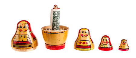 matroushka: Russian doll with dollars inside isolated on white background
