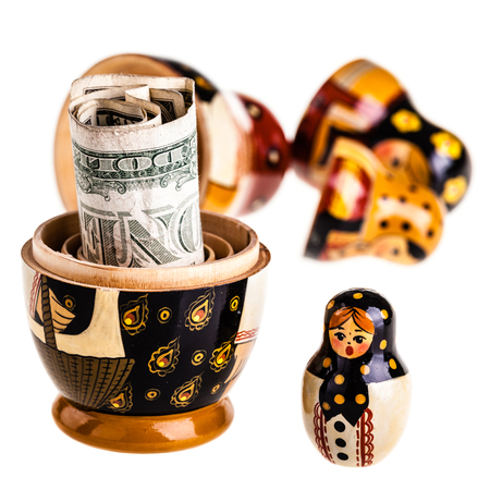 matroshka: Russian doll with dollars inside isolated on white background