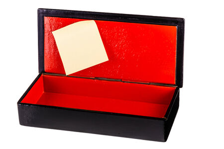 laquered: a black laquered box with a bright red interior and a post it isolated over white