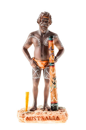 cultural artifacts: a small aborigine figurine isolated over a white background