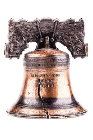 liberty bell: a small liberty bell reproduction isolated over a white background Stock Photo