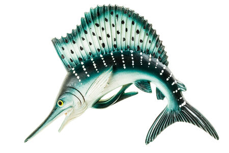 a small swordfish fridge magnet made in plastic and isolated over white photo