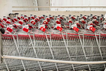 grocery store series: a row of shopping carts in front of a supermarket Stock Photo