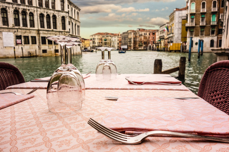 waterside: a romantic table set on the waterside in Venice, Italy Stock Photo