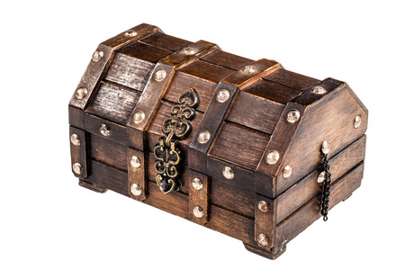 an ancient wooden chest isolated over a white  photo