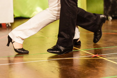 cha: unrecognizable people dancing on the stage of a small theater or a dance floor Stock Photo