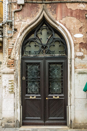 an old and pictoresque door in venice, italy photo