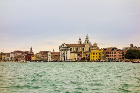 Ancient buildings along Canal Grande in Venice, Italy photo