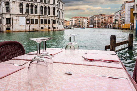 romantic dinner: a romantic table set on the waterside in Venice, Italy Stock Photo