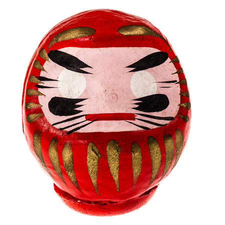 a japanese daruma doll isolated on white background
