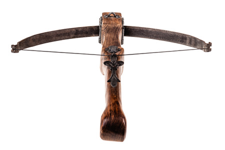 medieval weapons: an ancient medieval crossbow isolated over a white background Stock Photo