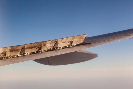 aileron: detail of the wing of a commercial airplane during flight Stock Photo